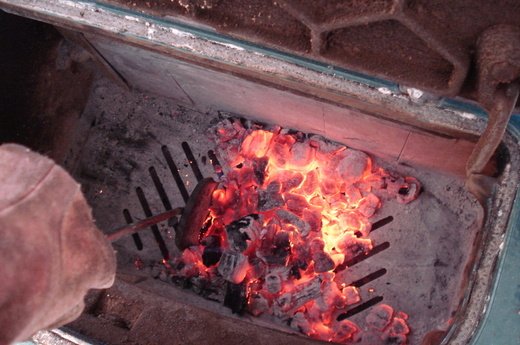 1st I rake the ash through the grate of the fire box. - Shades Of White: Stoking The Wood Stove